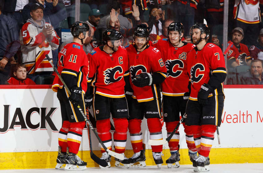 CALGARY, AB - JANUARY 9: Michael Frolik #67 of the Calgary Flames celebrates with teammates after a goal against the Colorado Avalanche at Scotiabank Saddledome on January 9, 2019 in Calgary, Alberta, Canada. (Photo by Gerry Thomas/NHLI via Getty Images)