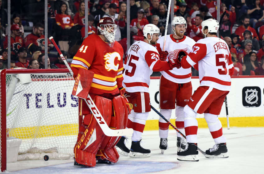 CALGARY, AB - JANUARY 18: Detroit Red Wings Defenceman Mike Green (25), Right Wing Anthony Mantha (39) and Defenceman Jonathan Ericsson (52) celebrate a goal on Calgary Flames Goalie Mike Smith (41) during the third period of an NHL game where the Calgary Flames hosted the Detroit Red Wings on January 18, 2019, at the Scotiabank Saddledome in Calgary, AB. (Photo by Brett Holmes/Icon Sportswire via Getty Images)