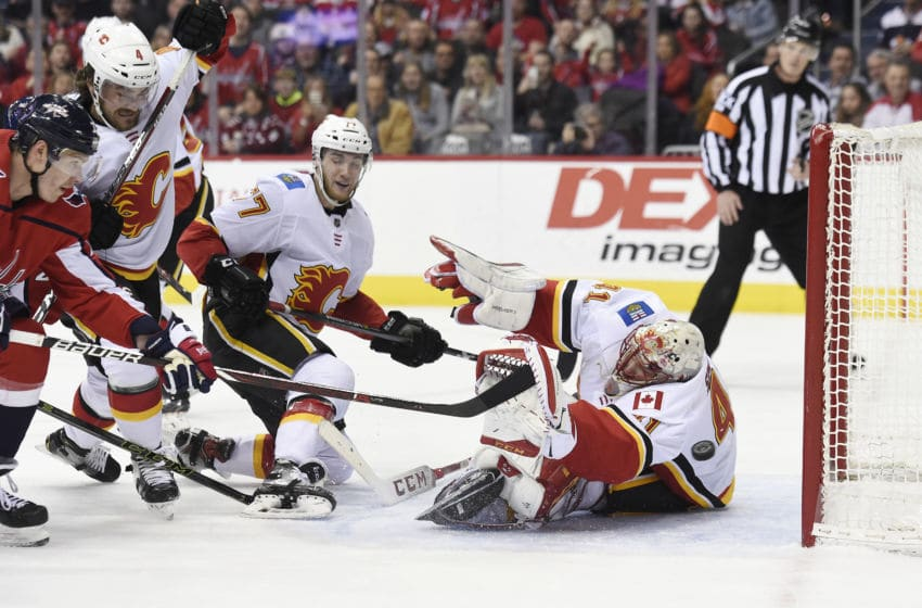 WASHINGTON, DC - FEBRUARY 01: Dmitrij Jaskin #23 of the Washington Capitals scores a goal against Mike Smith #41 of the Calgary Flames in the first period at Capital One Arena on February 1, 2019 in Washington, DC. (Photo by Patrick McDermott/NHLI via Getty Images)