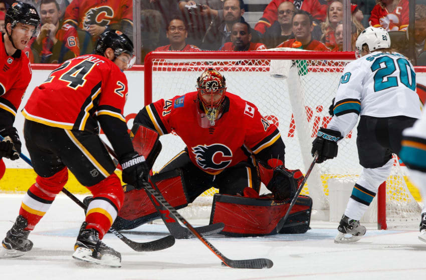 CALGARY, AB - FEBRUARY 7: Mike Smith #41 of the Calgary Flames keeps his eye on the puck against the San Jose Sharks at Scotiabank Saddledome on February 7, 2019 in Calgary, Alberta, Canada. (Photo by Gerry Thomas/NHLI via Getty Images)
