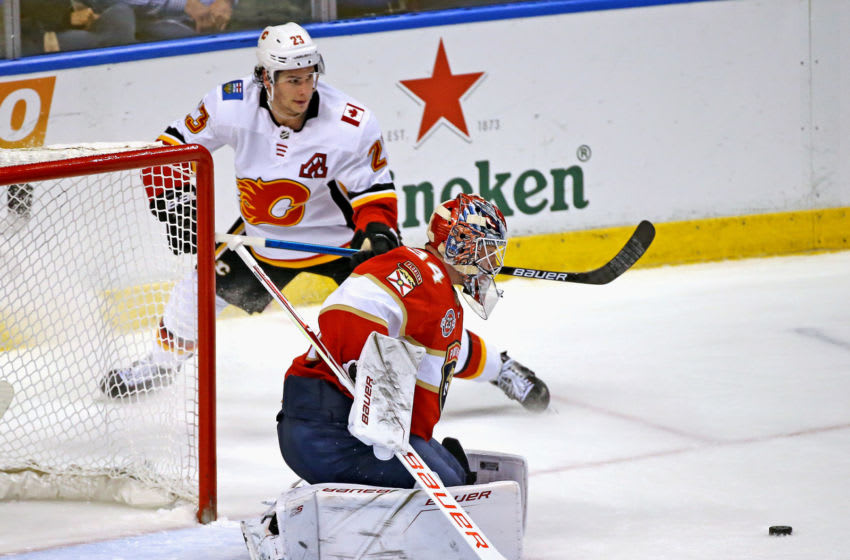 Florida Panthers goalie James Reimer (34) stops a shot by the Calgary Flames' Sean Monahan (23) during the second period at the BB&T Center in Sunrise, Fla., on Thursday, Feb. 14, 2019. (David Santiago/Miami Herald/TNS via Getty Images)