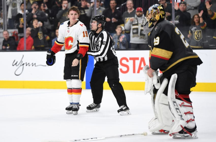 LAS VEGAS, NV - MARCH 06: Matthew Tkachuk #19 of the Calgary Flames is escorted off the ice after a penalty during the second period against the Vegas Golden Knights at T-Mobile Arena on March 6, 2019 in Las Vegas, Nevada. (Photo by Jeff Bottari/NHLI via Getty Images)