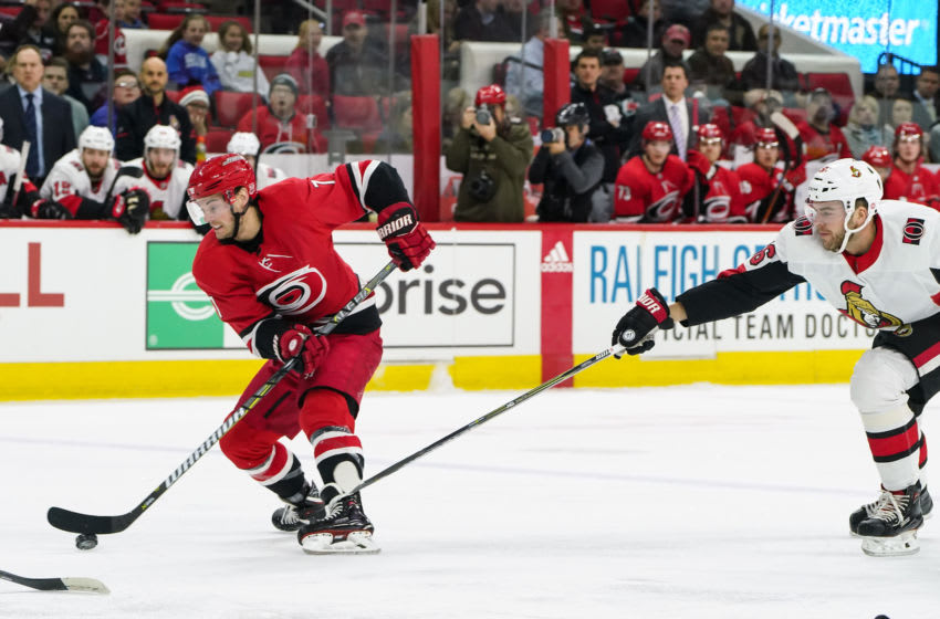 RALEIGH, NC - MARCH 26: Carolina Hurricanes Center Derek Ryan (7) is chased up the ice by Ottawa Senators Left Wing Magnus Paajarvi (56) during a game between the Ottawa Senators and the Carolina Hurricanes at the PNC Arena in Raleigh, NC on March 24, 2018. Carolina defeated Ottawa 4-1. (Photo by Greg Thompson/Icon Sportswire via Getty Images)