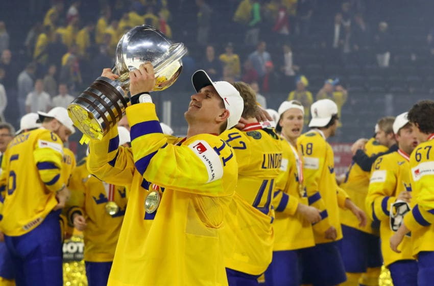 COPENHAGEN, DENMARK - MAY 20: Mikael Backlund of Sweden lifts the trophy after victory over Switzerland during the 2018 IIHF Ice Hockey World Championship Gold Medal Game game between Sweden and Switzerland at Royal Arena on May 20, 2018 in Copenhagen, Denmark. (Photo by Martin Rose/Getty Images)