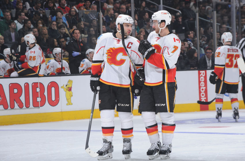 LOS ANGELES, CA - DECEMBER 22: Mark Giordano #5 of the Calgary Flames converses with T.J. Brodie #7 of the Calgary Flames during a game against the Los Angeles Kings at STAPLES Center on December 22, 2014 in Los Angeles, California. (Photo by Juan Ocampo/NHLI via Getty Images)