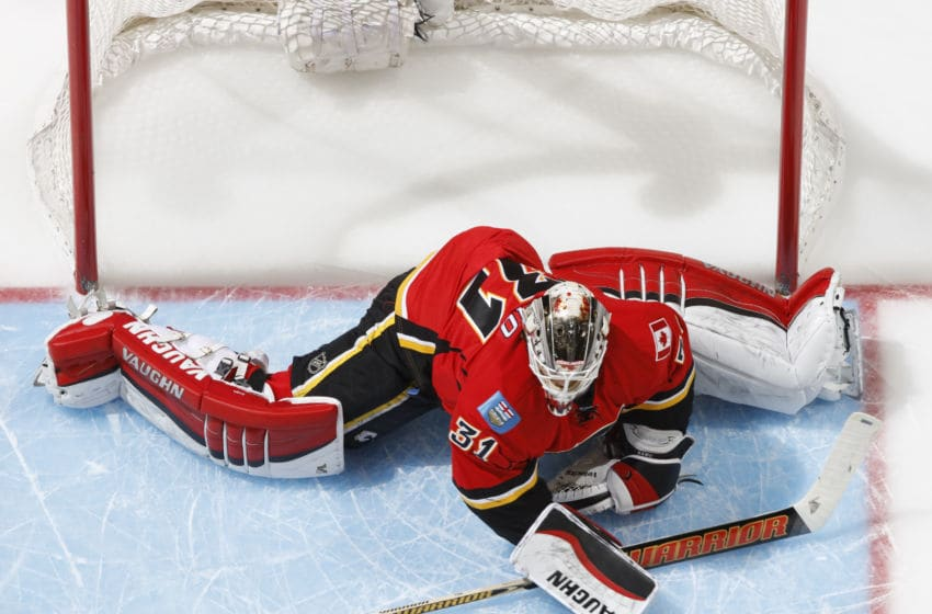 CALGARY, AB - FEBRUARY 5: Karri Ramo #31 of the Calgary Flames stretches in his crease against the Columbus Blue Jackets at Scotiabank Saddledome on February 5, 2016 in Calgary, Alberta, Canada. (Photo by Gerry Thomas/NHLI via Getty Images)