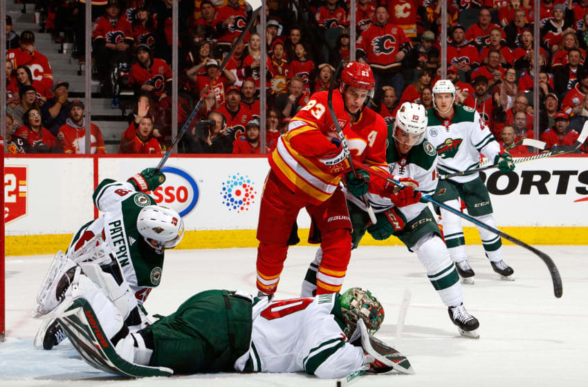CALGARY, AB - MARCH 2: Devan Dubnyk #40 of the Minnesota Wild jumps on a rebound during an NHL game against the Calgary Flames on March 2 18, 2019 at the Scotiabank Saddledome in Calgary, Alberta, Canada. (Photo by Gerry Thomas/NHLI via Getty Images)