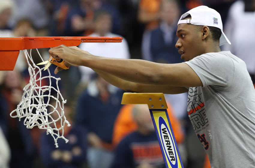 KANSAS CITY, MISSOURI - MARCH 31: Austin Wiley #50 of the Auburn Tigers celebrates by cutting down the net after their 77-71 win over the Kentucky Wildcats in the 2019 NCAA Basketball Tournament Midwest Regional at Sprint Center on March 31, 2019 in Kansas City, Missouri. (Photo by Christian Petersen/Getty Images)