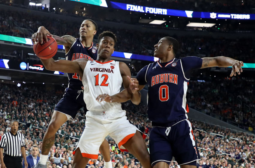 De'Andre Hunter #12 of the Virginia Cavaliers with J'Von McCormick #12 and Horace Spencer #0 of the Auburn Tigers (Photo by Streeter Lecka/Getty Images)