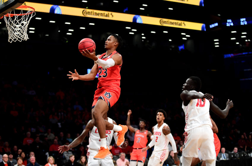 NEW YORK, NEW YORK - NOVEMBER 25: Isaac Okoro #23 of the Auburn Tigers jumps for a layup in the first half against the New Mexico Lobos at Barclays Center on November 25, 2019 in New York City. (Photo by Emilee Chinn/Getty Images)