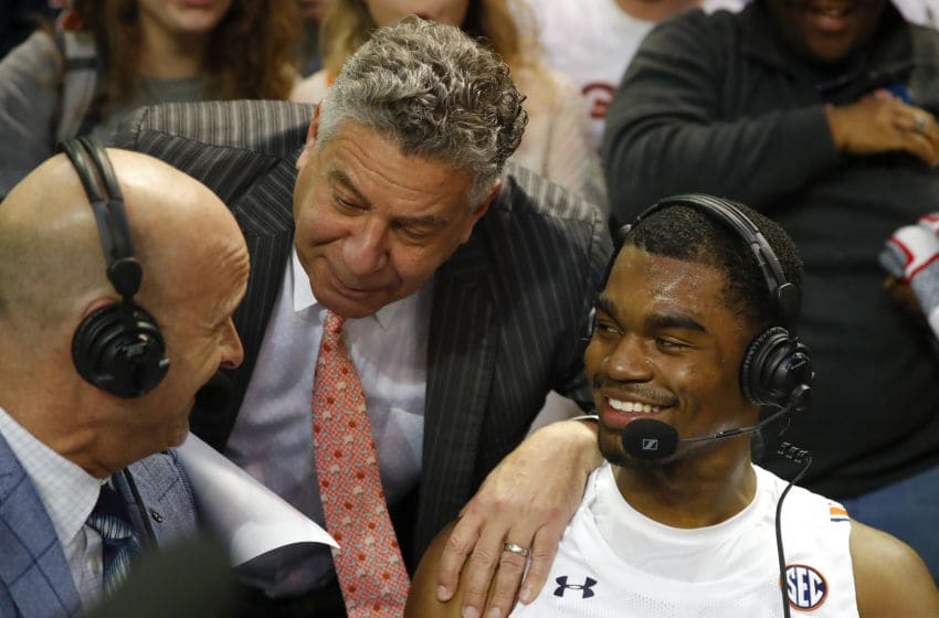 AUBURN, AL - JANUARY 22: Devan Cambridge #35 is joined by head coach Bruce Pearl of the Auburn Tigers as he is interviewed following the game against the South Carolina Gamecocks at Auburn Arena on January 22, 2020 in Auburn, Alabama. (Photo by Todd Kirkland/Getty Images)