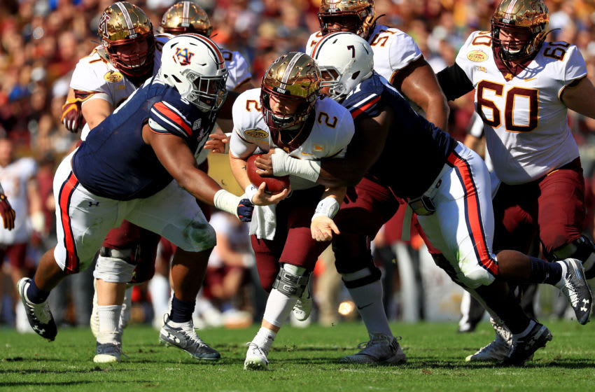 Tanner Morgan #2 of the Minnesota Golden Gophers is tackled by Nick Coe #91 of the Auburn Tigers (Photo by Mike Ehrmann/Getty Images)