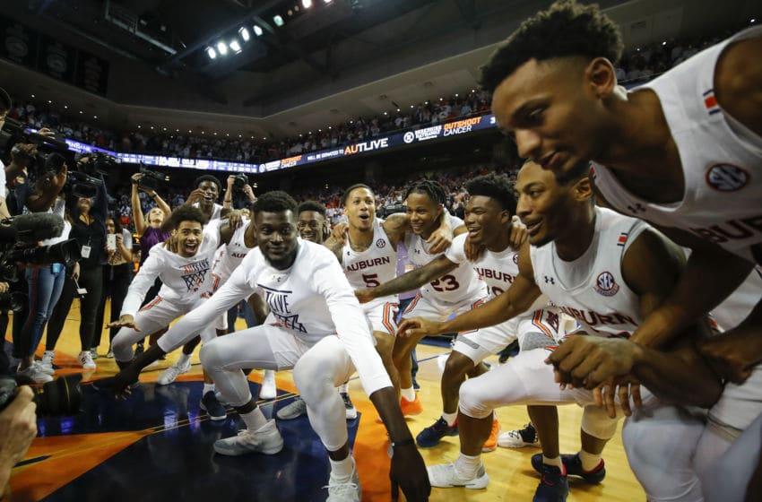 AUBURN, AL - FEBRUARY 01: Babatunde Akingbola #13 of the Auburn Tigers leads the team in a postgame celebration following their victory over the Kentucky Wildcats at Auburn Arena on February 1, 2020 in Auburn, Alabama. (Photo by Todd Kirkland/Getty Images)