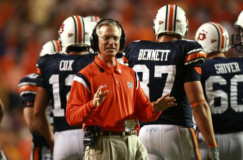 BATON ROUGE, LA - OCTOBER 20: Head coach Tommy Tuberville of the Auburn Tigers tries to ask the officials a question during a stoppage in play while taking on the LSU Tigers at Tiger Stadium on October 20, 2007 in Baton Rouge, Louisiana. (Photo by Doug Benc/Getty Images)