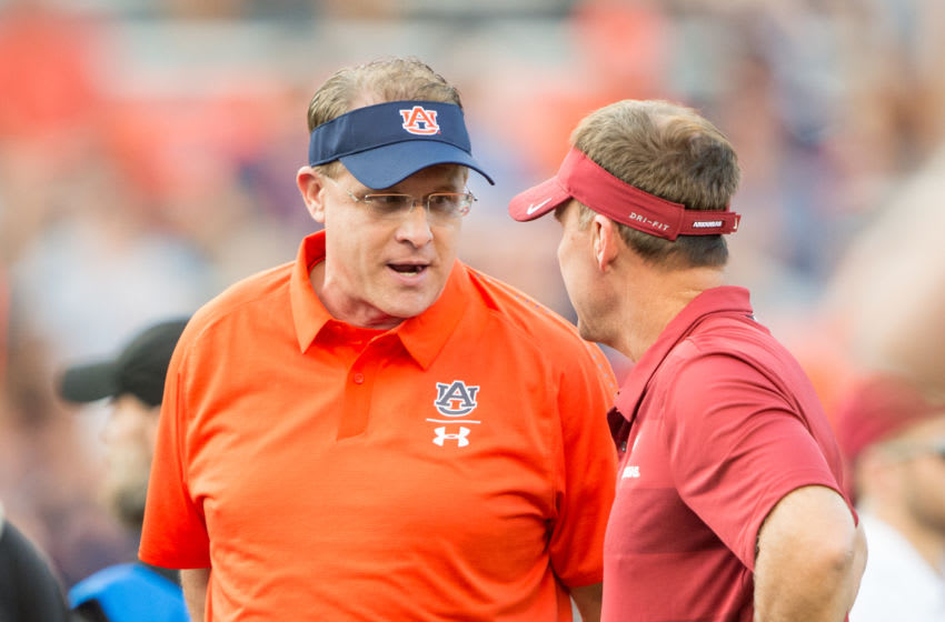 AUBURN, AL - SEPTEMBER 22: Head coach Gus Malzahn of the Auburn Tigers speaks with head coach Chad Morris of the Arkansas Razorbacks prior to their matchup at Jordan-Hare Stadium on September 22, 2018 in Auburn, Alabama. (Photo by Michael Chang/Getty Images)