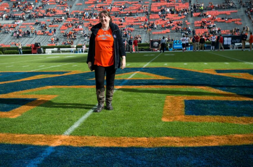 Dee Ford, a British women that was confused for former Auburn football linebacker Dee Ford on Twitter, poses for a picture at Jordan-Hare Stadium in Auburn, Ala., on Saturday, Nov.. 17, 2018.