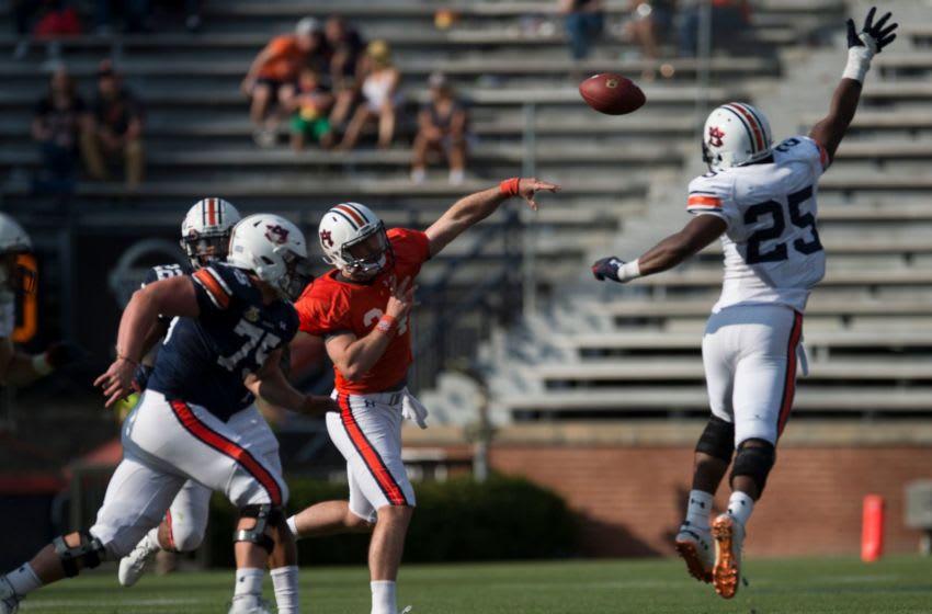 Auburn football quarterback Cord Sandberg (24) throws the ball over Auburn lineman Colby Wooden during the A-Day spring practice gameat Jordan-Hare Stadium in Auburn, Ala., on Saturday, April 13, 2019. Jc Auburnday 54