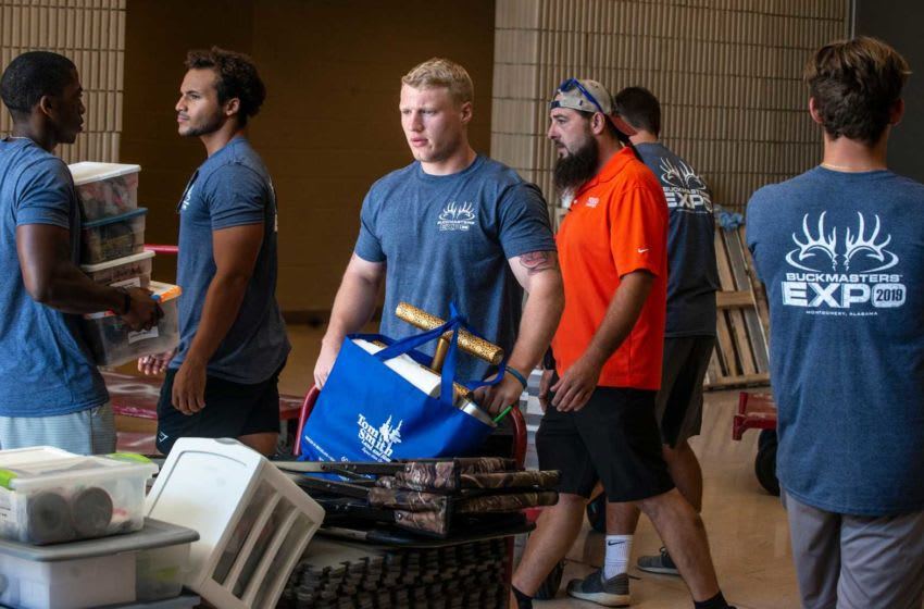 College baseball players from Auburn Montgomery help vendors bring in items during Buckmastes Expo setup day on Thursday, Aug. 15, 2019, at the Renaissance Montgomery Hotel & Spa at the Convention Center. Buckmasters 6