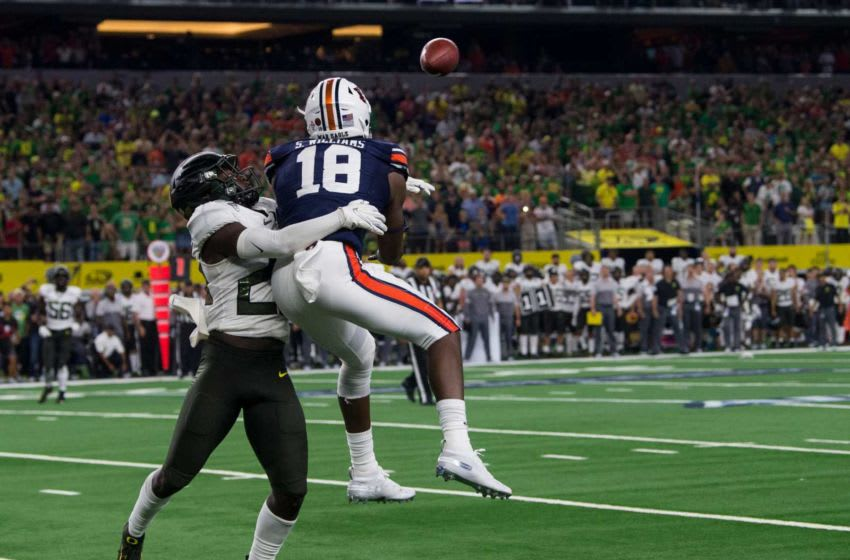 Auburn football wide receiver Seth Williams (18) catches the game winning touchdown pass guarded by Oregon defensive back Verone McKinley III (23) at AT&T Stadium in Arlington, Texas, on Saturday, Aug. 31, 2019. Auburn defeated Oregon 27-21. Jc Auburnoregon 60