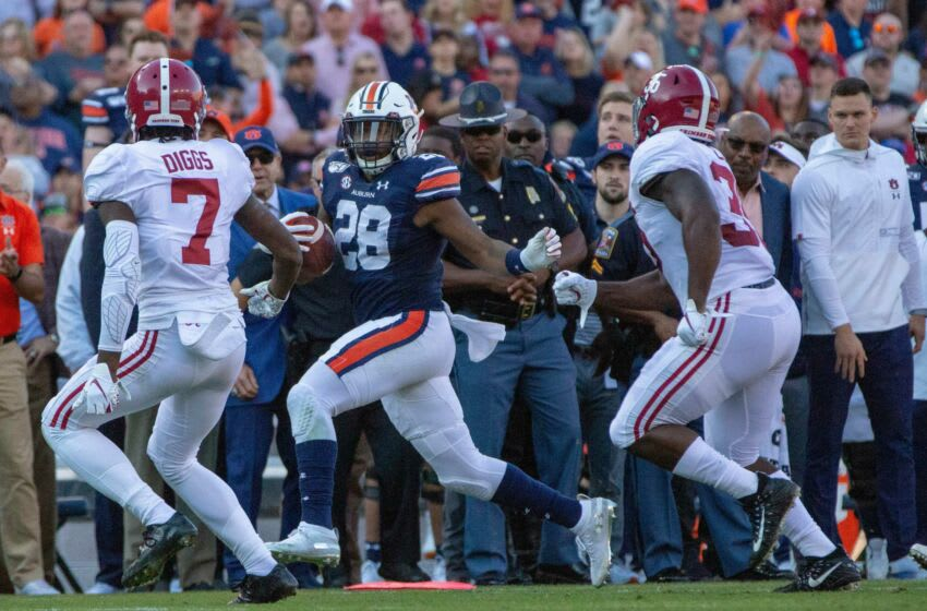 Auburn football running back JaTarvious Whitlow (28) runs the ball during the first quarter. Iron Bowl 2019