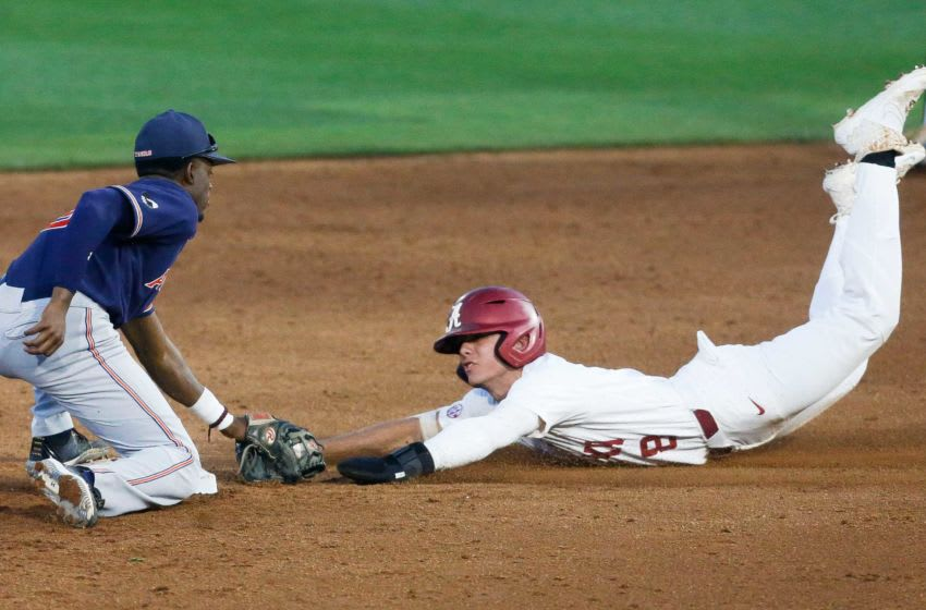 Auburn baseball shortstop Ryan Bliss takes a throw and tags out Alabama base runner Peyton Wilson (8) as he attempts to steal second in Sewell-Thomas Stadium Thursday, April 15, 2021. [Staff Photo/Gary Cosby Jr.]