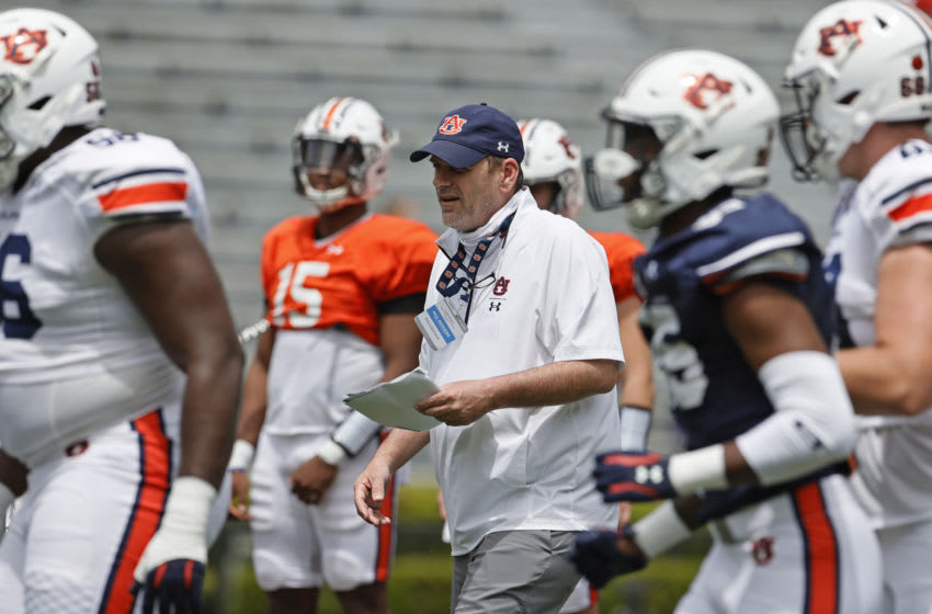 Apr 17, 2021; Auburn, Alabama, USA; Auburn Tigers offensive coordinator Mike Bobo watches his players in warmups before the start of the spring game at Jordan-Hare Stadium. Mandatory Credit: John Reed-USA TODAY Sports