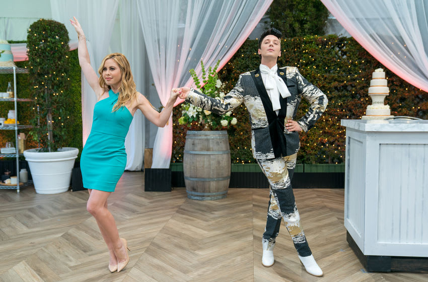 Hosts Tara Lipinski and Johnny Weir during the Cake Round, Wedding Cake for Meilani and Kevin, Say Yes to the Wedding (Dress) Cake, as seen on Wedding Cake Championship, Season 1.