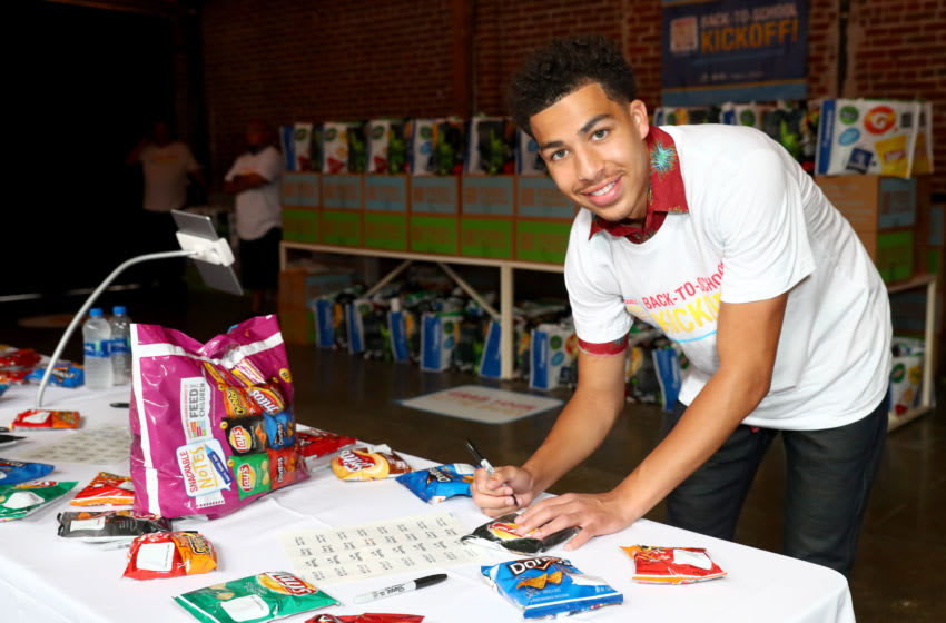 LOS ANGELES, CALIFORNIA - AUGUST 07: Actor Marcus Scribner joined Frito-Lay Variety Packs and Feed the Children in Los Angeles, California on Wednesday, August 7th to kick off its Snackable Notes program to help end childhood hunger by surprising families at a back-to-school meal drive event. For every Snackable Note written on a Frito-Lay chip bag and submitted at http://www.SnackableNotes.com, Frito-Lay Variety Packs will make a $1 donation to the anti-hunger organization, supplementing up to two million meals for struggling families. (Photo by Joe Scarnici/Getty Images for Frito-Lay North America )