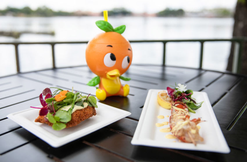 Highlights from the Citrus Blossom marketplace in the Taste of EPCOT International Food & Wine Festival include, from left, Crispy Citrus Chicken with Orange Aioli and Baby Greens, an Orange Cream Shake in a Souvenir Orange Bird Sipper Cup and Lobster Tail with Meyer Lemon Emulsion and Grilled Lemon. This is the 25th year for the EPCOT culinary festival at Walt Disney World Resort in Lake Buena Vista, Florida. (Steven Diaz, photographer)