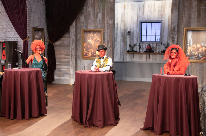 Carla, Zac and Stephanie at judges table smiling to camera, as seen on Halloween Baking Championship, Season 6. Photo provided by Food Network