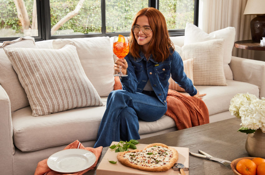 A match made in pizza, actress and self-proclaimed 'President of the Spritz Fan Club' Zoey Deutch enjoys an Aperol Spritz in her home, photo provided by Courtesy of Justin Coit Aperol