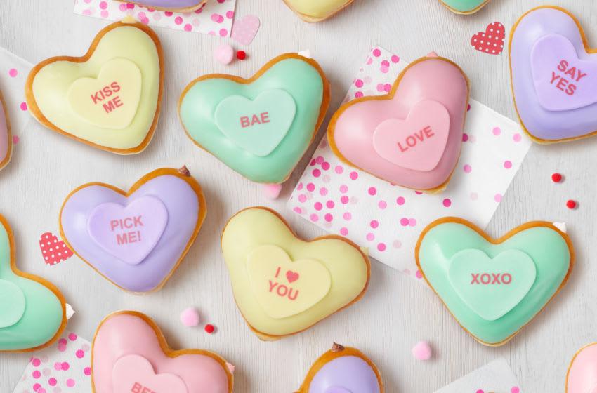Kripsy Kreme Conversation Heart Doughnuts are back for Valentine's Day, photo provided by Krispy Kreme