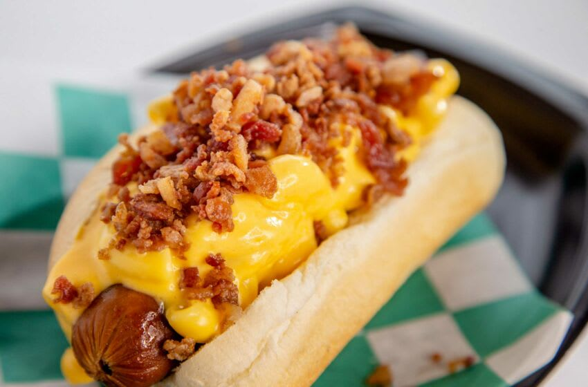The Bacon Mac Dog, a 100% Angus beef hot dog in a bun is smothered in mac 'n' cheese and sprinkled with bacon is one of the top 10 new fair foods for 2021, Tuesday, July 13, 2021. Fairfood1 Jpg