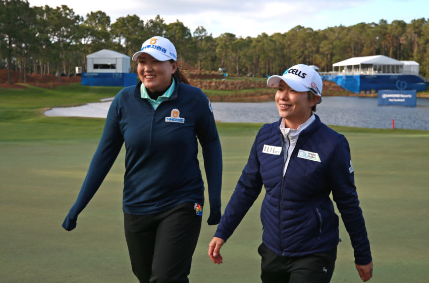 Eun-Hee Ji of South Korea walks off the green with Mirim Lee after winning the Diamond Resorts Tournament of Champions at Tranquilo Golf Course at Four Seasons Golf and Sports Club Orlando on January 20, 2019 in Lake Buena Vista, Florida. (Photo by Matt Sullivan/Getty Images)