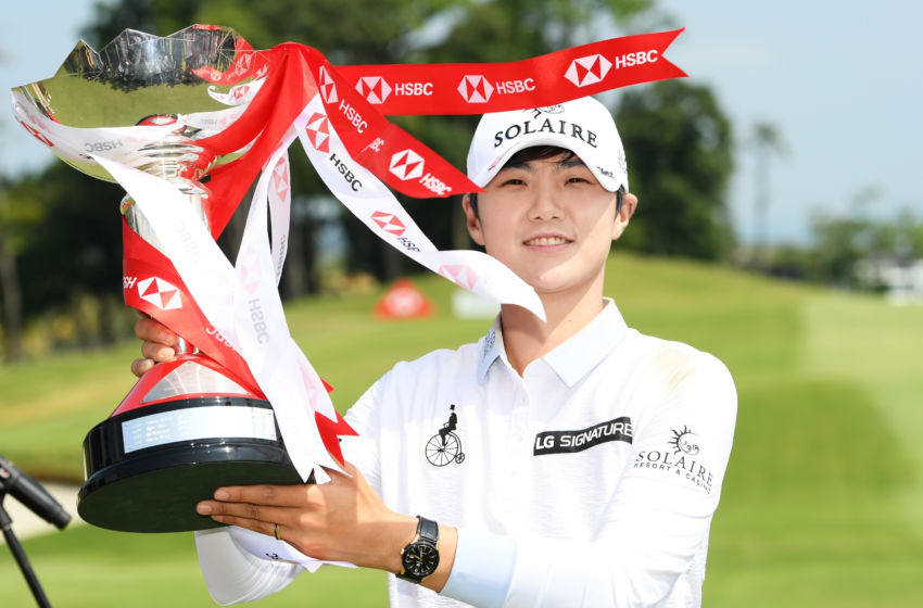 Sung Hyun Park of South Korea celebrates with the winner's trophy after the final round of the HSBC Women's World Championship at Sentosa Golf Club on March 03, 2019 in Singapore. (Photo by Ross Kinnaird/Getty Images)