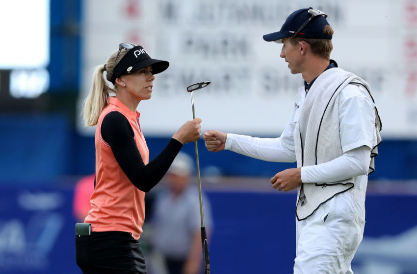 Pernilla Lindberg of Sweden knocks fists with her caddie and fiancee Daniel Taylor after her birdie on 18 secured her a three shot lead heading into the final round during the third round of the 2018 ANA Inspiration on the Dinah Shore Tournament Course at Mission Hills Country Club on March 31, 2018 in Rancho Mirage, California. (Photo by David Cannon/Getty Images)
