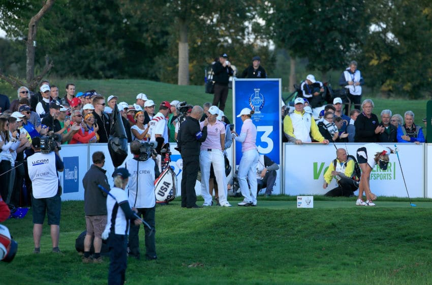 SANKT LEON-ROT, GERMANY - SEPTEMBER 19: Azahara Munoz and Carlota Ciganda of the European Team are warned for slow play by LET Rules official Michael Jon on the 13th hole against Cristie Kerr and Lexi Thompson of the United States during the afternoon fourball matches in the 2015 Solheim Cup at St Leon-Rot Golf Club on September 19, 2015 in Sankt Leon-Rot, Germany. (Photo by David Cannon/Getty Images)