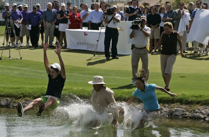 Lorena Ochoa of Mexico jumps into the pond alongside 18th green after winning the LPGA Kraft Nabisco Championship at the Mission Hills Country Club in Rancho Mirage, CA. (Photo by Charles Baus/Icon SMI/Icon Sport Media via Getty Images)