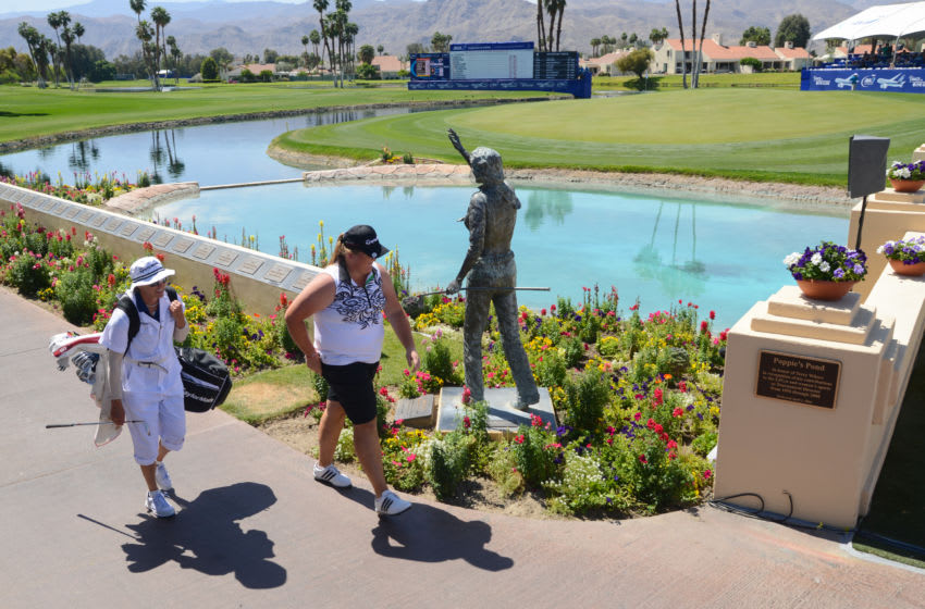 Amatuer Haley Moore walks past the Dinah Shore Statue prior to walking across the bridge over Poppy's Pond at the 18th greeb in the ANA Inspiration Round Three at Mission Hills Country Club on April 4, 2015 in Rancho Mirage, California. (Photo by Kent C. Horner/Getty Images for ANA)