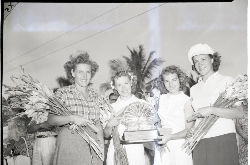 (Original Caption) 2/5/50-Hollywood, Florida- The Bauer sisters, Alice (l, center) and Marlene, of Midland, TX, hold the trophy after winning the 5th Annual Women's International Four-Ball Golf Tournament, at Hollywood, FL, 2/5. Runners-up are Betty Bush (l) of Hammond, IN, and Betty McKinnon (r) of Mt. Pleasant, TX. The Bauer sisters won 6 and 5 in the 36-hole finals on the Orange Brook Golf Club course.