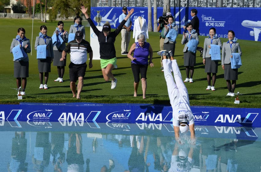 Pernilla Lindberg of Sweden jumps into the water with her fiance Daniel Taylor and her parents Jan and Gunilla Lindberg after winning the the ANA Inspiration on the Dinah Shore Tournament Course at Mission Hills Country Club on April 2, 2018 in Rancho Mirage, California. (Photo by Robert Laberge/Getty Images)