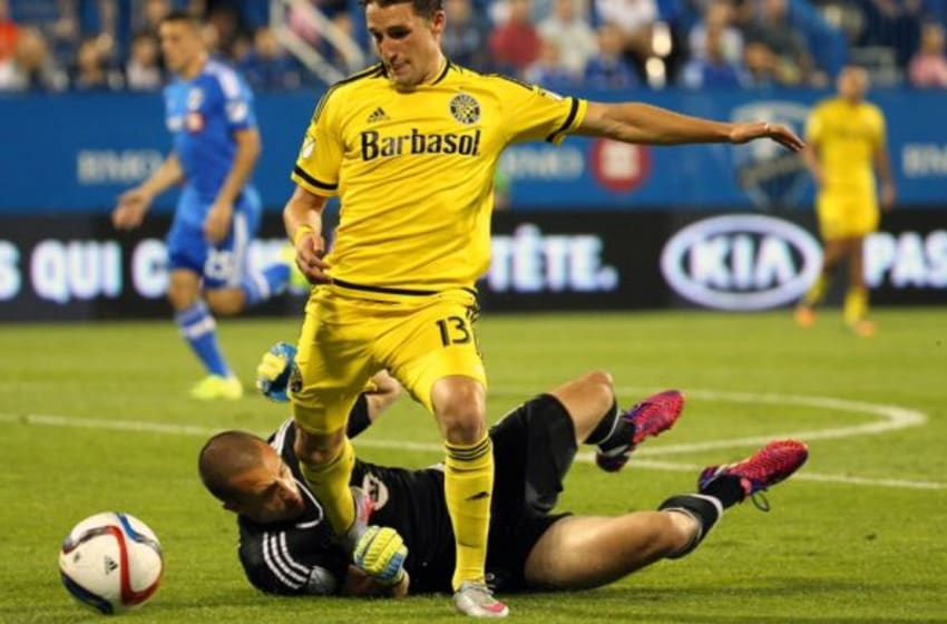 Jul 11, 2015; Montreal, Quebec, CAN; Montreal Impact goalkeeper Evan Bush (1) makes a save against Columbus Crew midfielder Ethan Finlay (13) during the second half at Stade Saputo. Mandatory Credit: Jean-Yves Ahern-USA TODAY Sports