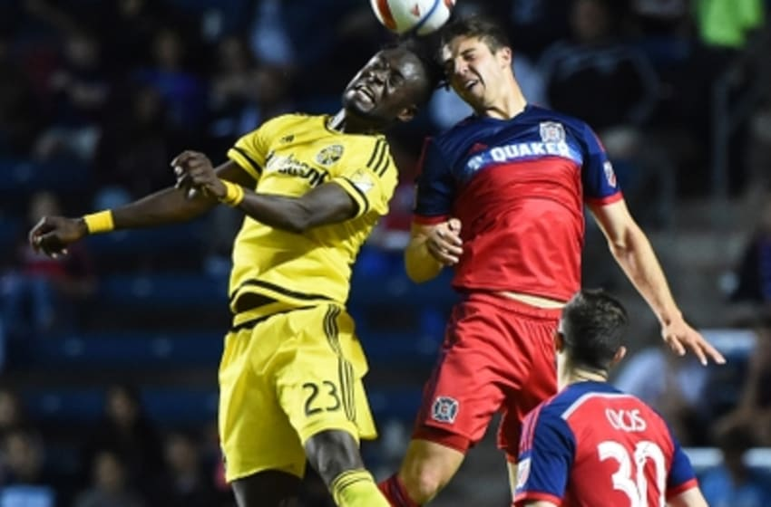 Jul 15, 2015; Chicago, IL, USA; Chicago Fire defender Matt Polster (2) and Columbus Crew forward Kei Kamara (23) head the ball during the second half at Toyota Park. Columbus Crew defeated the Chicago Fire 1-0. Mandatory Credit: Mike DiNovo-USA TODAY Sports