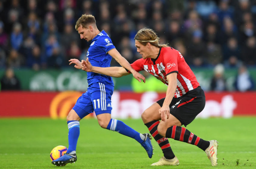 LEICESTER, ENGLAND - JANUARY 12: Marc Albrighton of Leicester City holds off Jannik Vestergaard of Southampton during the Premier League match between Leicester City and Southampton FC at The King Power Stadium on January 12, 2019 in Leicester, United Kingdom. (Photo by Ross Kinnaird/Getty Images)