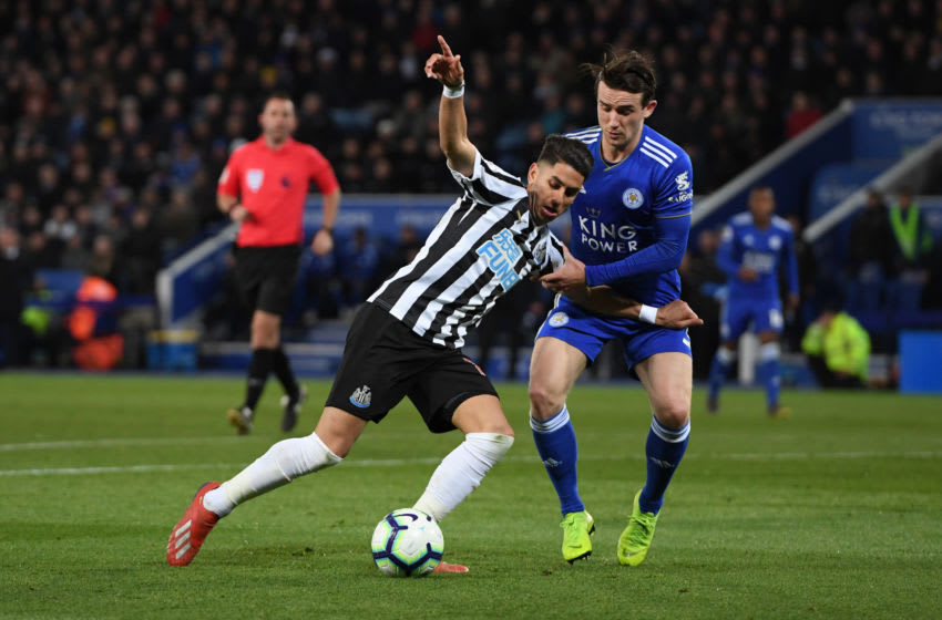LEICESTER, ENGLAND - APRIL 12: Ayoze Perez of Newcastle United is challenged by Ben Chilwell of Leicester City during the Premier League match between Leicester City and Newcastle United at The King Power Stadium on April 12, 2019 in Leicester, United Kingdom. (Photo by Ross Kinnaird/Getty Images)