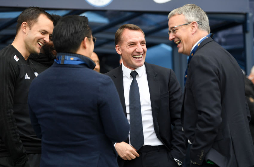 MANCHESTER, ENGLAND - MAY 06: Brendan Rodgers, Manager of Leicester City speaks to Aiyawatt Srivaddhanaprabha, Leicester City chairman (L) pitch side prior to the Premier League match between Manchester City and Leicester City at Etihad Stadium on May 06, 2019 in Manchester, United Kingdom. (Photo by Michael Regan/Getty Images)