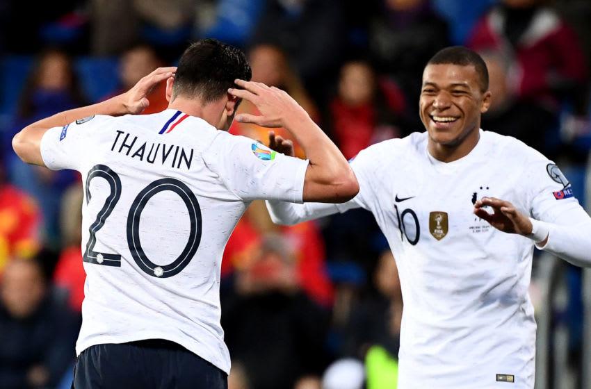 France's Florian Thauvin, Kylian Mbappe (FRANCK FIFE/AFP via Getty Images)