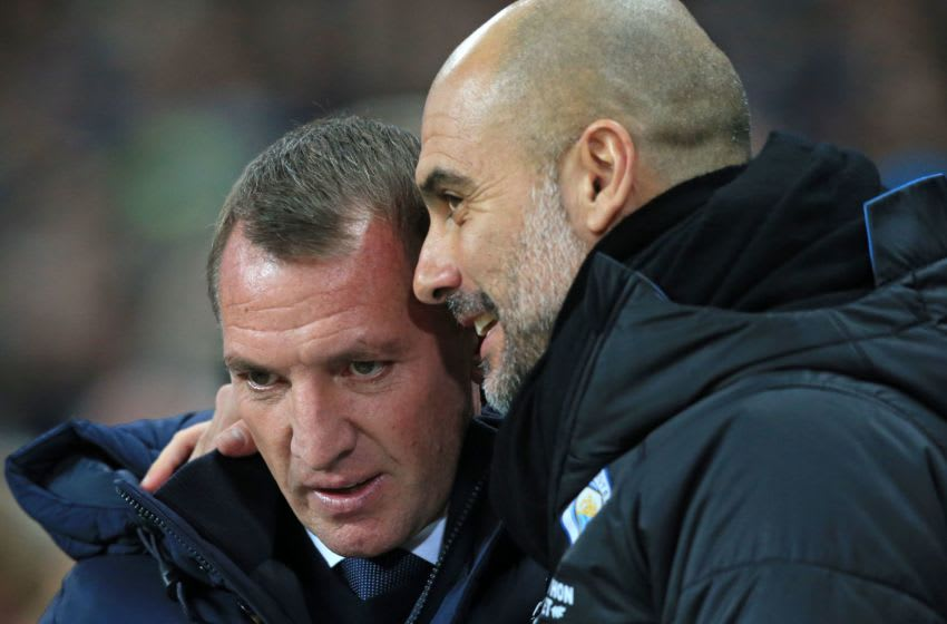 Pep Guardiola, Brendan Rodgers (Photo by LINDSEY PARNABY/AFP via Getty Images)