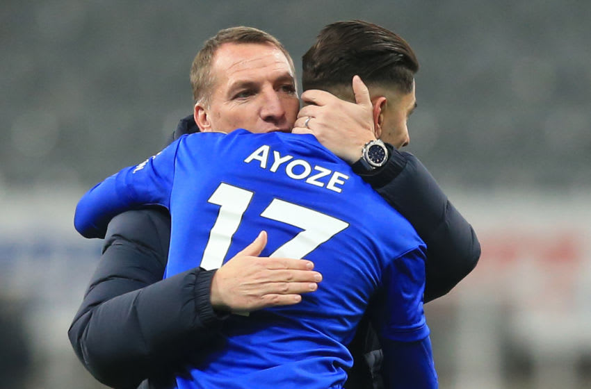Leicester City's Northern Irish manager Brendan Rodgers (L) embraces Leicester City's Spanish striker Ayoze Perez after winning the English Premier League football match between Newcastle United and Leicester City at St James' Park in Newcastle-upon-Tyne, north east England on January 1, 2020. (Photo by Lindsey Parnaby / AFP) / RESTRICTED TO EDITORIAL USE. No use with unauthorized audio, video, data, fixture lists, club/league logos or 'live' services. Online in-match use limited to 120 images. An additional 40 images may be used in extra time. No video emulation. Social media in-match use limited to 120 images. An additional 40 images may be used in extra time. No use in betting publications, games or single club/league/player publications. / (Photo by LINDSEY PARNABY/AFP via Getty Images)