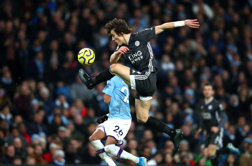 MANCHESTER, ENGLAND - DECEMBER 21: Caglar Soyuncu of Leicester City clears the ball ahead of Riyad Mahrez of Manchester City during the Premier League match between Manchester City and Leicester City at Etihad Stadium on December 21, 2019 in Manchester, United Kingdom. (Photo by Clive Brunskill/Getty Images)
